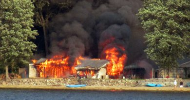 A photo of the house on fire.
