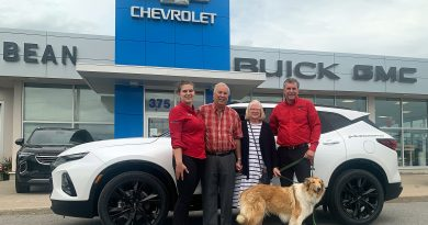 A photo of the Bean family at their Carleton Place dealership.
