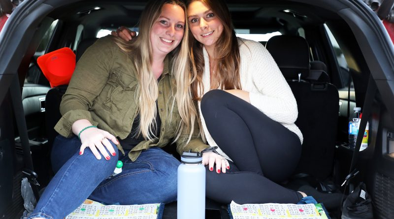 A photo of Cassandra McLaurin and Jacquelean Baroud in the back of their car.