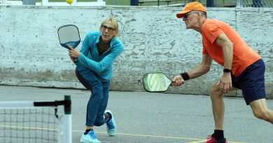 Two players compete in pickleball.