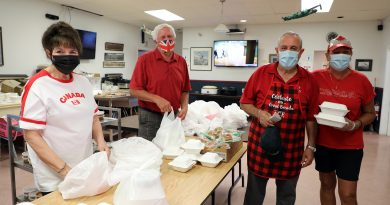 A photo of volunteers preparing the Canada Day Meals to Wheels dinner.