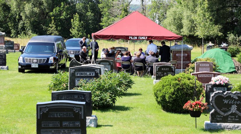 A photo of the funeral service.