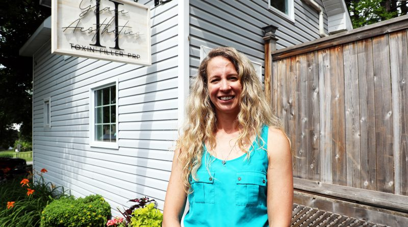 A photo of Dr. Jody Timpson in front of her clinic.