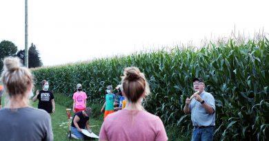 A photo of Paul Sullivan explaining crop yield.