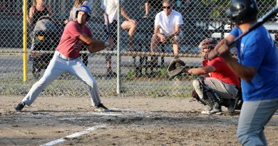 Harbour Ball player Ben Wilson takes a swing.