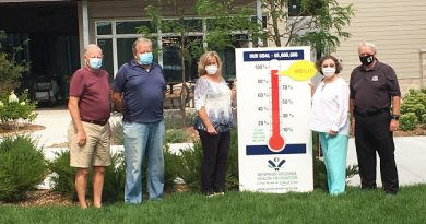 Arnprior Regional Health Foundation board members show off their super-hot thermometer.