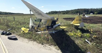 A photo of the two-seater, crashed airplane.