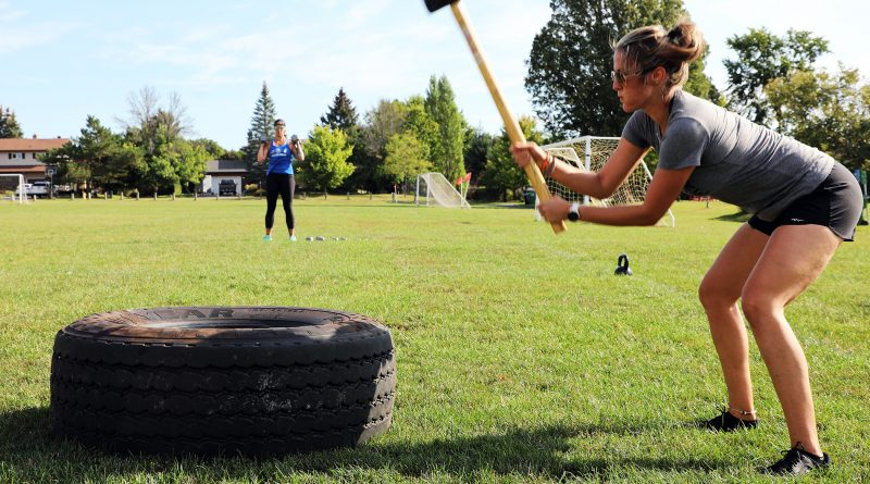 Carp's Kayla Musselman hits a tire with a sledge.