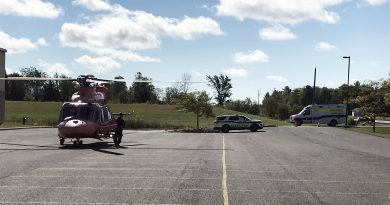 A photo of the ORNGE helicopter landing at the Kinburn arena.