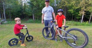 From left, Quinn, Brendan and Kyle pose with some of their rides.