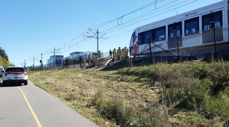 Firefighters ensure the derailed LRT train is stable for Transportation Safety Board investigators. Photo by Steven Grant