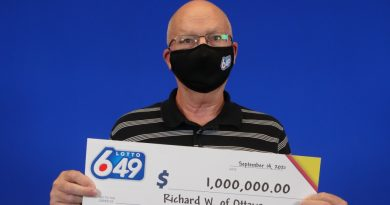 Richard Wiles shows off his really big cheque.