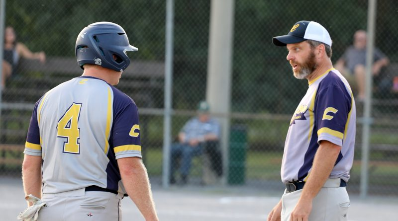 A photo of two fastball players congratulating each other.