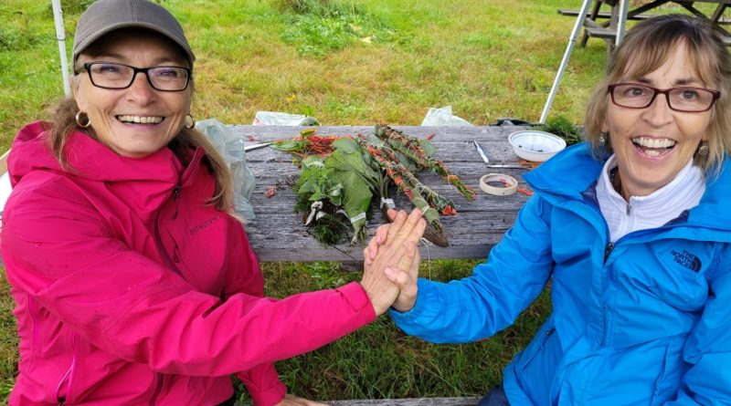 Lesley Cochran-Hulcoop and Joanne Moore celebrate a successful foraging trip in the Carp Hills.