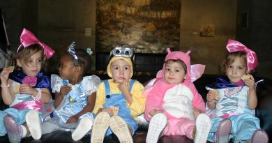 A photo of toddlers in Hallowe'en costumes.