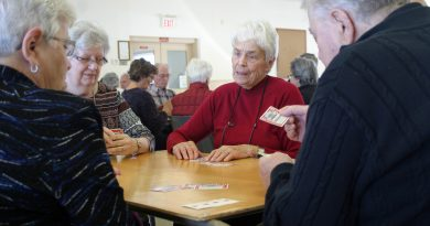 A photo of people playing euchre.