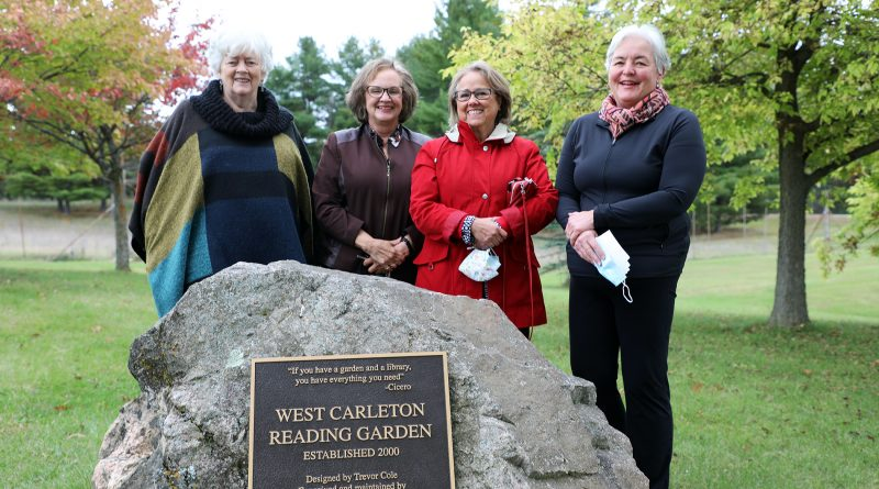 A photo of four members of the garden glub in the reading garden.
